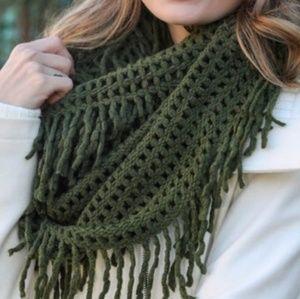 Soft acrylic infinity scarf with fringe.